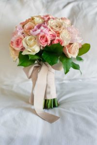 Wedding bouquet of pink and cream roses